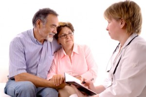 Couple discuss options with doctor