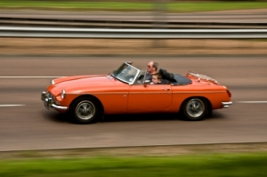 Take turns test-driving an MG convertible car with the sunroof down!